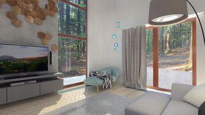 W salonie można się zrelaksować na leżance. Wisząca dekoracyjna lampa delikatnie podkreśla odcienie błękitu - kolor dodatków we wnętrzu.