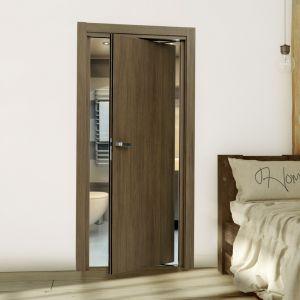 Aranżacja z drzwiami Płaskie w systemie Rondo w okleinie z kolekcji Natura orzech jupiter. Fot. Inter Door