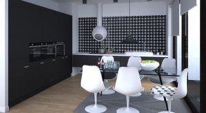 Nowoczesny, urządzony w duchu minimalizmu apartament zachwyca połączeniem czerni i bieli.