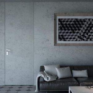 Aranżacja z drzwiami Płaskie w okleinie z kolekcji HPL betonart, z ukrytą ościeżnicą i podwyższonym skrzydłem. Fot. Inter Door