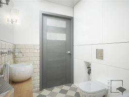 Łazienka z kremowymi płytkami cegiełkami.