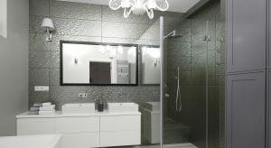 Dominującą w tej łazience szarość przybiera różne formy – od połyskującej rybiej łuski po klasyczne, frezowane fronty.Przełamują ją jedynie białe akcenty.