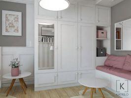 Widok na szafę wraz z miejscem do siedzenia