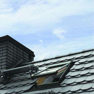 Przygotowanie dachu do zimy. Fot. Okpol