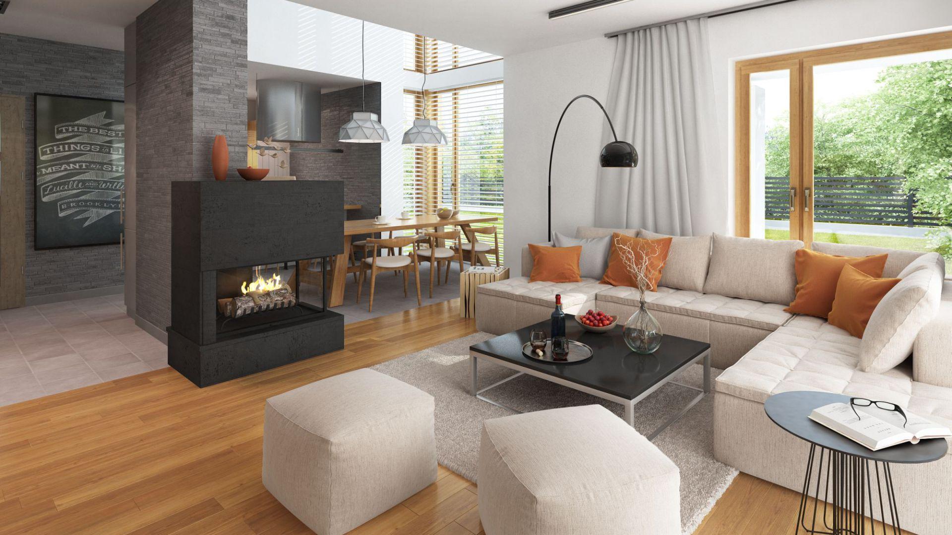 Zaprojektowany w domu kominek uprzyjemni mieszkańcom niejeden jesienno-zimowy wieczór. Projekt: Marcin Abramowicz, Jagoda Gruca, Dobre Domy