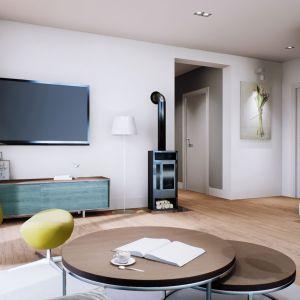 Strefa dzienna domu to udane połączenie ascetycznej bieli, modnych szarości oraz błękitnych i kanarkowych akcentów, które dodają całości wyjątkowego uroku i ciepła.Dom Mini 1 G1. Projekt: arch. Artur Wójciak. Fot. Pracownia Projektowa Archipelag