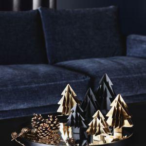 kolekcja świątecznych dodatków, które pomogą stworzyć atmosferę hygge w każdym domu: lśniące metale, jedyne w swoim rodzaju ręczne ozdoby, ciepłe tkaniny i wiele więcej. Fot. BoConcept