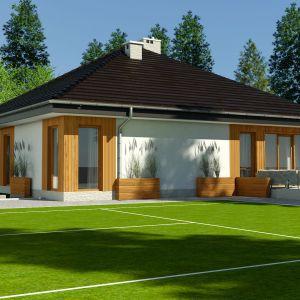 Jeśli ktoś szuka pomysłu na parterowy, mały dom, to Kalandra okaże się idealnym wyborem. Projekt: arch. Maja Klimowicz. Fot. Dom dla Ciebie Pracownia Projektowa Archeco