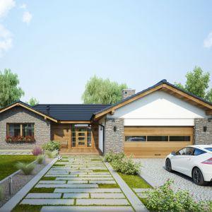 Ten pełen wdzięku dom o powierzchni ponad 140 m2 to propozycja skierowana do rodzin ceniących niebanalny wygląd i funkcjonalne rozwiązania. Projekt: Marcin Abramowicz, Marta Zaperty-Adamek. Fot. Dobre Domy