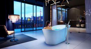 Łazienka w eleganckim apartamencie z pięknym dużym oknem prezentuje się niezwykle atrakcyjnie zwłaszcza wieczorem, gdy za obszerną szybą tarasową migocą kolorowe światła wielkiego miasta.