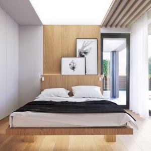 Duże przeszklenia i bezpośrednie połączenie z ogrodem to atuty usytuowania sypialni. Projekt i zdjęcia: Zespół Projektowy HomeKONCEPT