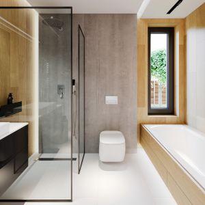 Aranżacja łazienki jest bardzo praktyczna, znalazło się tu miejsce zarówno na wannę, jak też prysznic. Projekt i zdjęcia: Zespół Projektowy HomeKONCEPT
