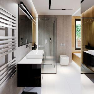 Poza dominującą w całym domu bielą i drewnem, łazienkę dodatkowo ożywiają czarne elementy. Projekt i zdjęcia: Zespół Projektowy HomeKONCEPT