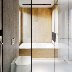 Szare płytki imitujące beton oraz drewno doskonale się uzupełniają. Projekt i zdjęcia: Zespół Projektowy HomeKONCEPT