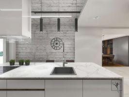 Kuchnia, choć wizualnie otwarta pozostaje jednak wyraźnie wydzielona z części dziennej apartamentu. Projekt: Marcin Gałuszka, Marcin Janus, Frog Studio