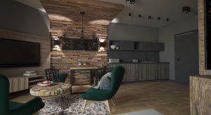 Naturalne drewno i butelkowa zieleń - te dwa znakomicie dopełniające się motywy zdominowały niewielki apartament z widokiem na góry.