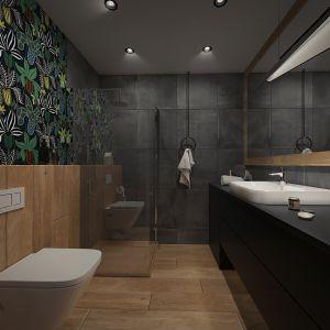 Niewielka, wąska łazienka utrzymana jest w stosowanych szarościach. Projekt: Beata Wołkowska, VIVINO Studio