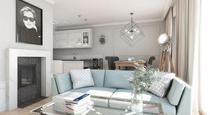 Już stając w progu mieszkania nie mamy wątpliwości co do stylu, w jakim zaaranżowano wnętrze. Komfortowe, tapicerowane meble, błyszczące chromowane dodatki, efektowne lampy - wszystko charakteryzuje szyk i elegancja typowe dla stylistyki glamour.