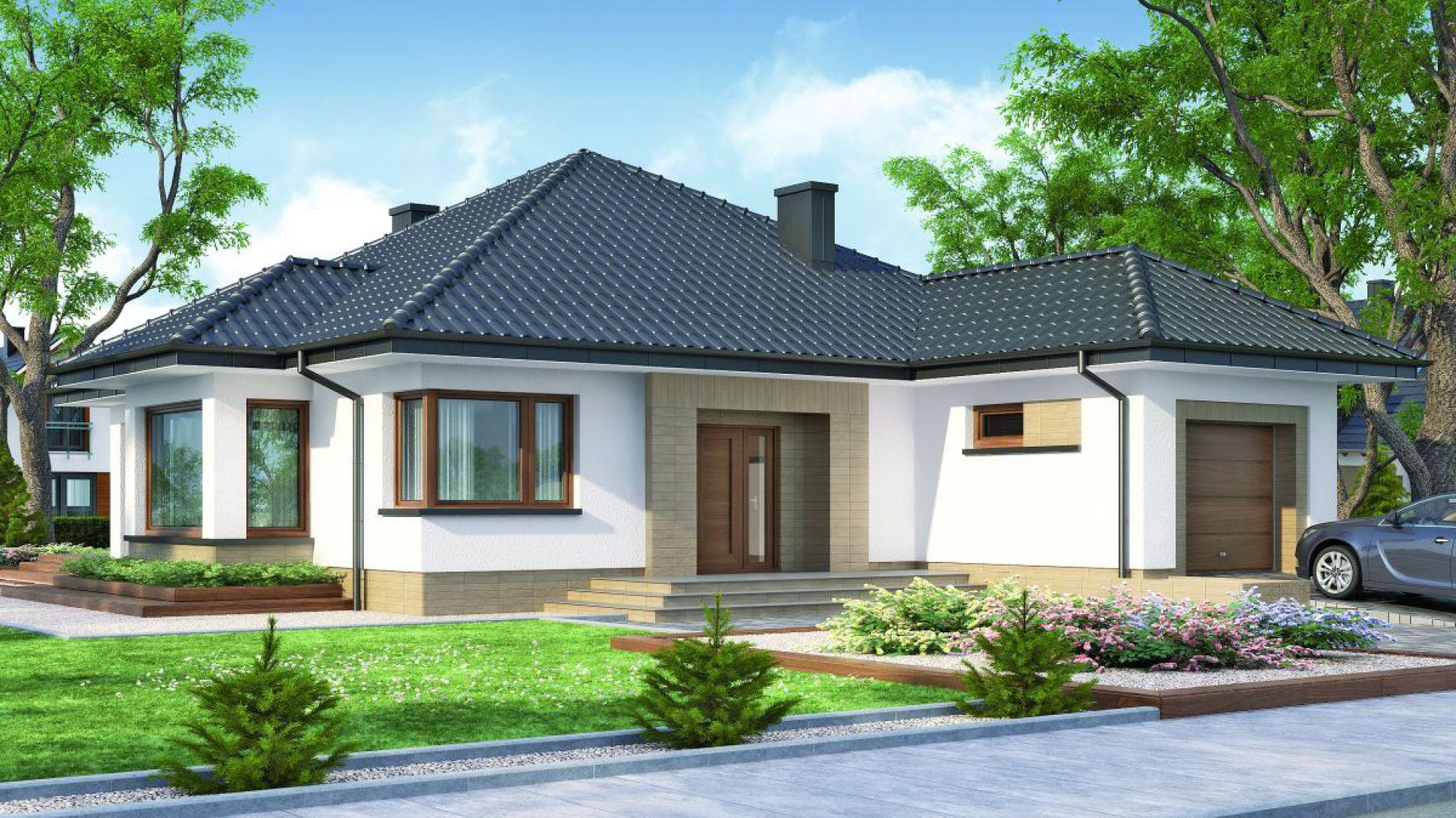 Hipokrates to wygodny dom parterowy, idealny dla 4-osobowej rodziny. Wyważonej i przyjemnej w odbiorze bryle budynku nowoczesności i charakteru dodają narożne okna i drewniana okładzina na elewacji. Powierzchnia użytkowa: 113,85 m². Koszt budowy domu (stan deweloperski, bez instalacji) - 336.883 zł. Projekt Hipokrates, Fot. Domena