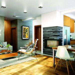W niewielkim domu z poddaszem o powierzchni 96 metrów zaprojektowano salon połączony z jadalnią o metrażu 24 metrów.  Proj. Dom w żurawkach. Fot. Archon +