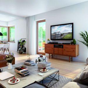 Dom o powierzchni 113 metrów kryje w sobie salon o powierzchni 22 metrów. Salon płynnie łączy się z jadalnią o powierzchni blisko 8 metrów. Proj. Dom w amarylisach. Fot. Archon +