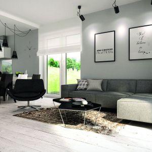 W parterowym domu o powierzchni 103 metrów kwadratowych zaprojektowano salon z jadalnia o metrażu 22 metrów. Proj. Kiwi 3. Fot. MTM Styl