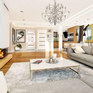 W domu o powierzchni blisko 110 metrów ma salon i jadalnię o powierzchni 35 metrów. Proj. Nektarynka, Fot. MG Projekt