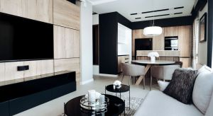 Pierwotnie w mieszkaniu znajdowały się dwa pokoje, aneks kuchenny z niewielkim salonem i mała łazienka. Inwestorzy pragnęli nowoczesnego wnętrza z funkcjonalną kuchnią i przytulnym salonem. Projektantka postanowiła więc przeprowadzić całkowit�