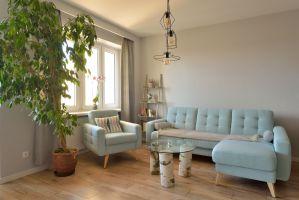 Otwarta strefa dzienna - część wypoczynkowa. Projekt i zdjęcia: Szymon Kamiński / Koncept Beautiful Inside