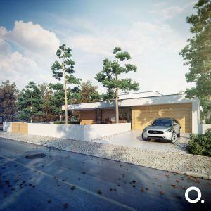 Aby chronić domowników przed hałasem i zapewnić intymność, budynek został wykończony od frontu ślepą elewacją. Projekt: Studio.O. organic design