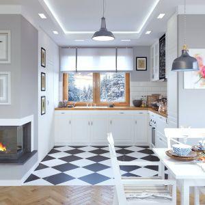 Kuchnia jest usytuowana nieco na uboczu. Jest urządzona bardzo nowocześnie, a biały kolor optycznie powiększa wnętrze. Dom Dla Ciebie 1 (B). Projekt: arch. Tomasz Pisaniak, arch. Maja Klimowicz. Fot. Archeco
