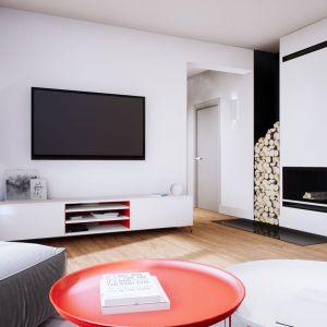 Serce domu Mini 3 ogrzewa dekoracyjny kominek, przy którym można przyjemnie zrelaksować się w chłodniejsze dni. Dom Mini 3. Fot. Pracownia Projektowa Archipelag