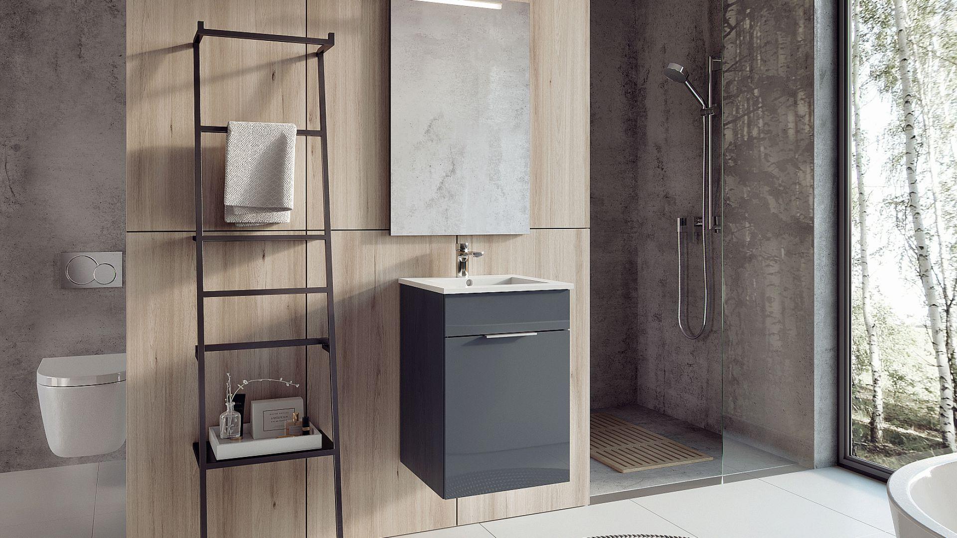 Kolekcja mebli QUBO PLUS stworzona z myślą o małych łazienkach, z zachowaniem stylu i elegancji. Kolory: biały, antracyt, dąb wenge, silver elm. Cena: 567,87 zł/ szafka z umywalką. Fot. Elita