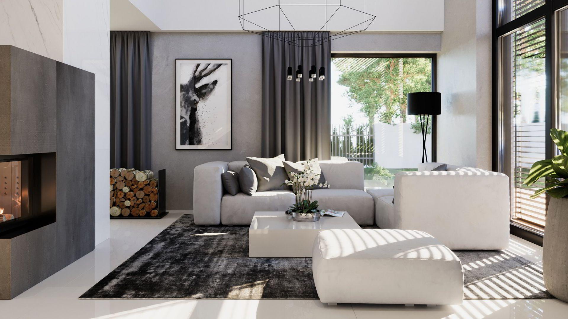 W salonie dominuje biel, szarości i drewno. Dom HomeKONCEPT 49. Fot. HomeKONCEPT