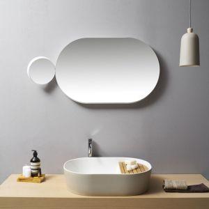 Większe i mniejsze lustra z serii Gravity zdają się przyciągać nawzajem; proj. Samuel Wilkinson. Fot. Ex-t