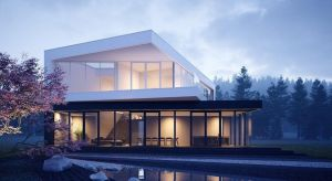"""Projekt domu """"czarno na białym"""" charakteryzuje minimalizm i równowaga. Głównym założeniem było otwarcie budynku na otaczającą go przestrzeń, dlatego dwie prostopadłe ściany na parterze i piętrze zostały wykonane ze szklanych tafli."""
