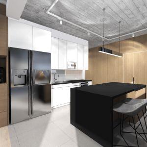 Doskonałym łącznikiem tych części domu jest kącik do parzenia kawy z ekspresem i miejscem na wszelkie przybory zaawansowanego kawosza. Projekt: TWORZYWO studio. Fot. TWORZYWO studio