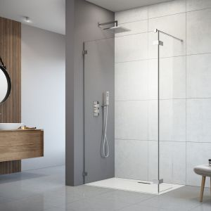 Kabiny typu walk in sprawdzają się zarówno w przestronnych pokojach kąpielowych, jak i w niewielkich łazienkach w bloku. Tafla czystego szkła nie zaburza aranżacji i nie zmniejsza optycznie wnętrza. Na zdjęciu kabina Arta Walk In. Fot. Radaway