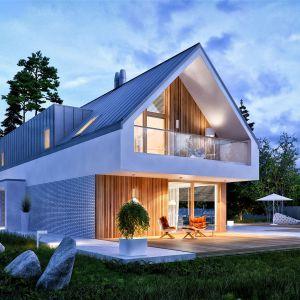 Projekt stawia na prostotę, harmonię i funkcjonalność, oferując ponad 154 m2 komfortowo rozplanowanej przestrzeni. Dom EX 20 G2 Energo Plus. Projekt: arch. Artur Wójciak. Fot. Pracownia Projektowa Archipelag