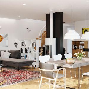 Na parterze mieści się rodzinna strefa dzienna, praktyczna część gospodarcza oraz sporych rozmiarów garaż, który udało się zgrabnie wkomponować w bryłę budynku. Dom EX 20 G2 Energo Plus. Projekt: arch. Artur Wójciak. Fot. Pracownia Projektowa Archipelag