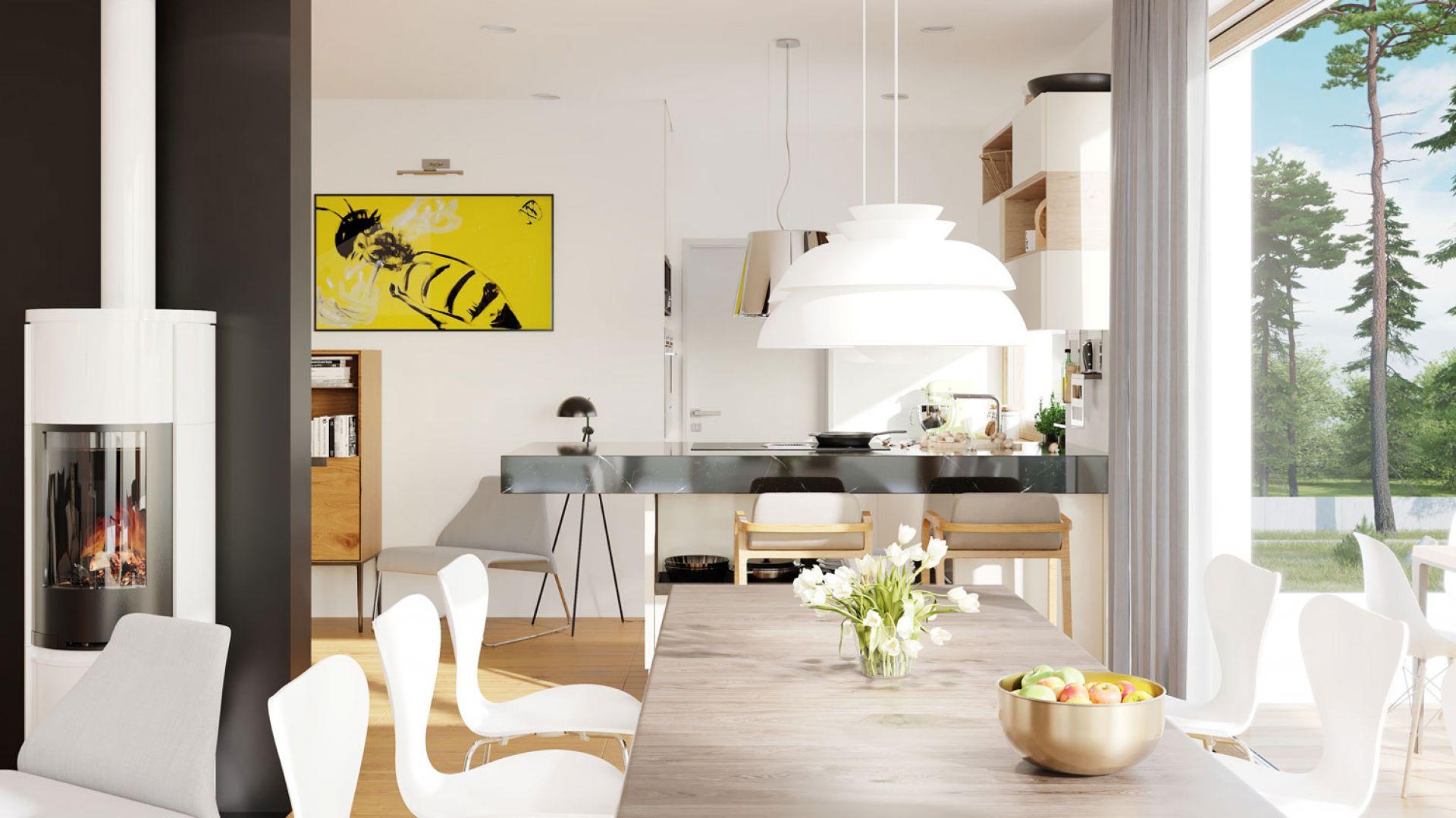 W kuchni architekci z Pracowni Archipelag zaplanowali modną wyspę, która ucieszy wszystkich miłośników rodzinnego gotowania. Dom EX 20 G2 Energo Plus. Projekt: arch. Artur Wójciak. Fot. Pracownia Projektowa Archipelag