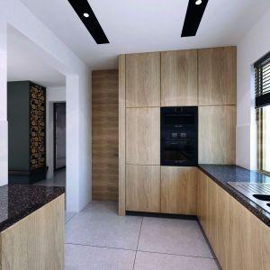 Decyma 6 jest projektem energooszczędnym. Atutem jest duży dwustanowiskowy garaż oraz spiżarnia usytuowana przy kuchni. Dom Decyma 6. Projekt: arch. Tomasz Sobieszuk. Fot. Domy w Stylu