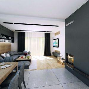 W pokoju dziennym znalazło się też nieco miejsca na ciekawe półki za kanapą. Dom Decyma 6. Projekt: arch. Tomasz Sobieszuk. Fot. Domy w Stylu