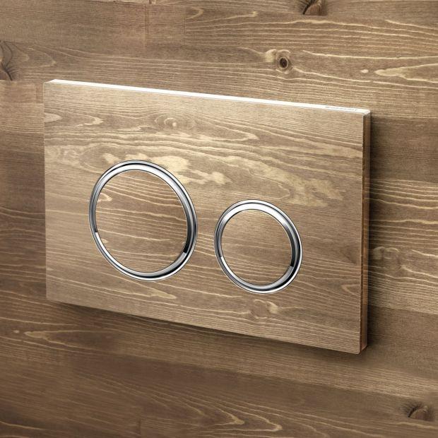 Modna łazienka - designerski przycisk spłukujący
