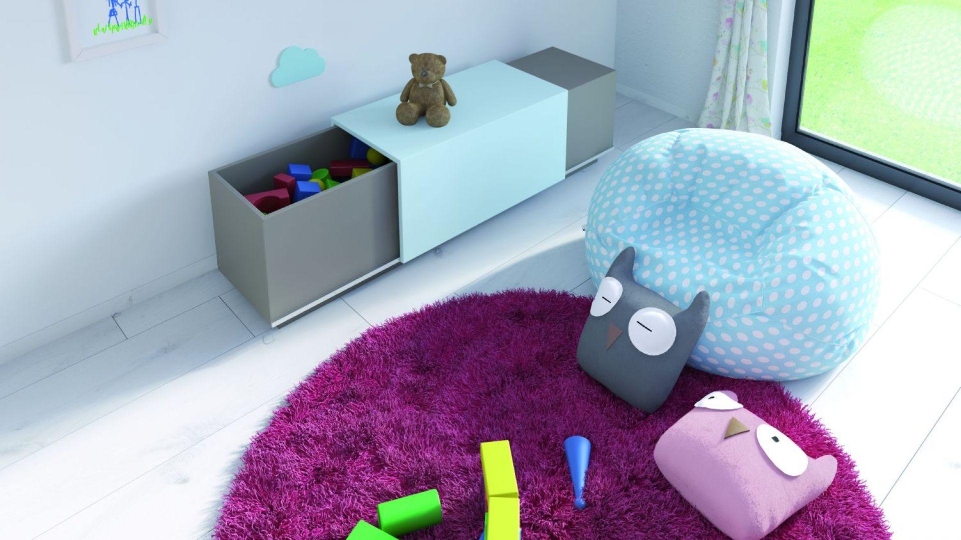 Okucie SlideLine M do niedużych frontów przesuwnych pozwala projektować meble, które zachwycą rodziców pomysłowością. Po skończonej zabawie wystarczy wrzucić zabawki do środka i delikatnie zasunąć front. Fot. Hettich