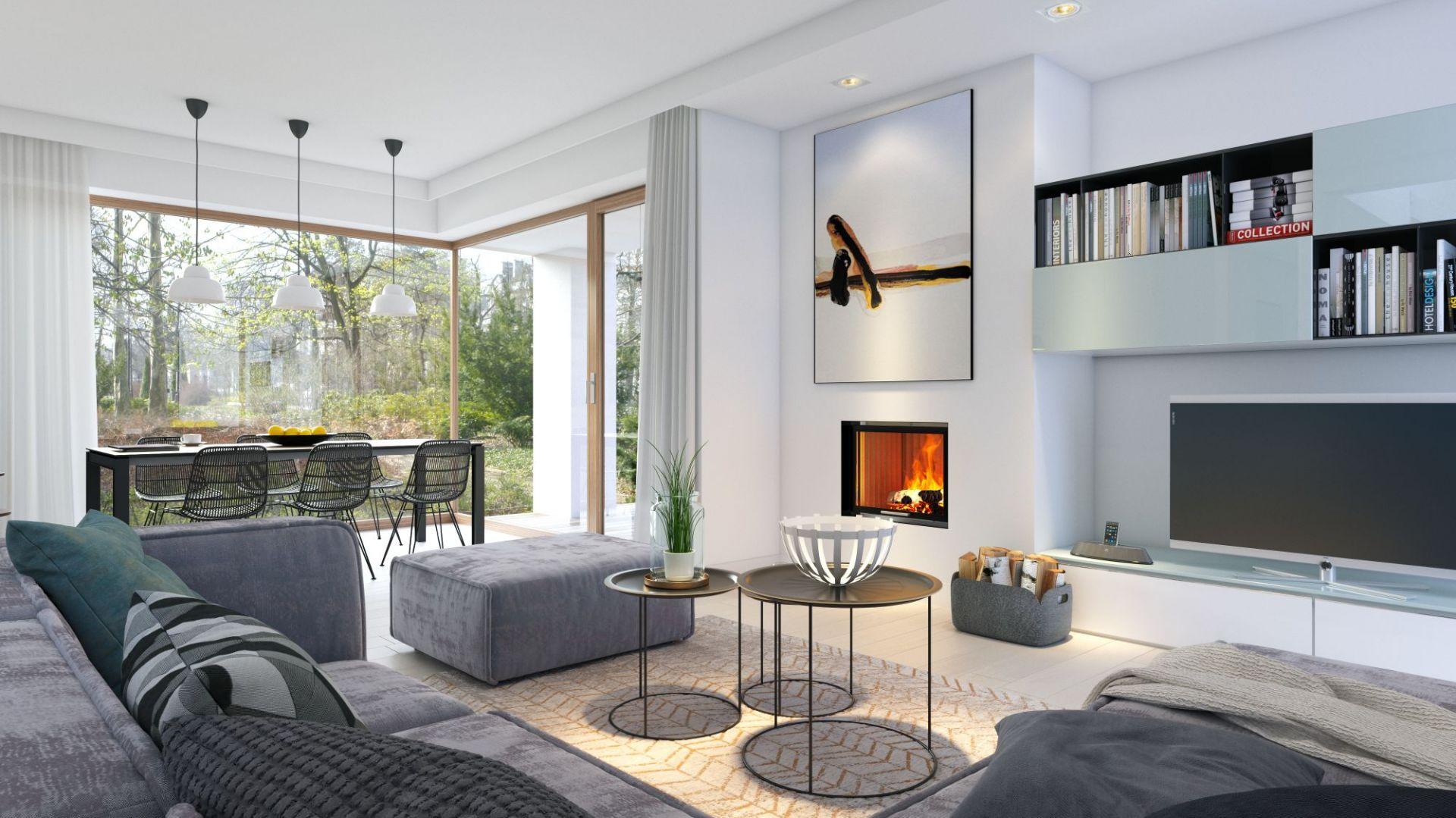 W minimalistycznie urządzonym salonie ozdobą wnętrza jest kominek. Dom Miły 1. Projekt: arch. Elżbieta Wysocka, arch. Krzysztof Borowski. Fot. Domy z Wizją