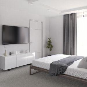 W sypialni postawiono na delikatne odcienie beżów i brązu. Dom Ariel 4. Projekt: arch. Tomasz Sobieszuk. Fot. Domy w Stylu