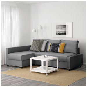 Sofa narożna Frihtenz pojemnikiem, kolor ciemnoszary. Wielkość łóżka po rozłożeniu: 140 cm x 204 cm. Miejsce do przechowywania pod szezlongiem. Pokrywa pozostaje otwarta, więc można bezpiecznie i wygodnie wyjmować rzeczy. Cena: 1.499 zł. Fot. Ikea