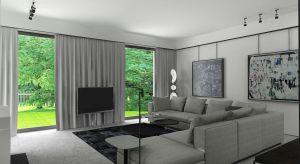 Ponadczasowe i eleganckie wnętrza domu w Piasecznie utrzymane są w stylu modernistycznym. Projektant wzbogacił przestrzeń o elementy nadające poczucie komfortu i ciepła.