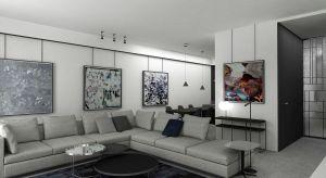 Eleganckie wnętrza domu w Piasecznie utrzymane są w stylu modernistycznym. Ważną rolę w otwartej przestrzeni dziennej będzie odgrywać sztuka, na którą zarezerwowano większość ścian. Projektant wprowadziłrównież do wnętrzaelementy nada